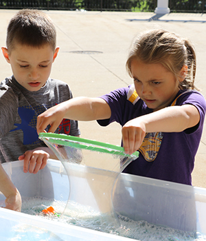 children making bubbles