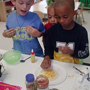 child making quesadillas