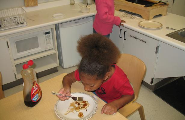 eating pancakes
