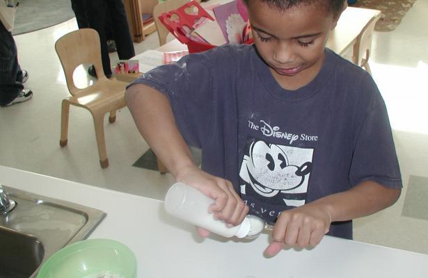 Child pouring liquid