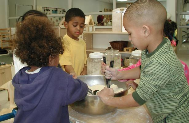 Group of children cooking