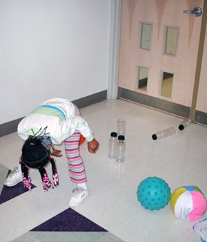 child playing with target ball